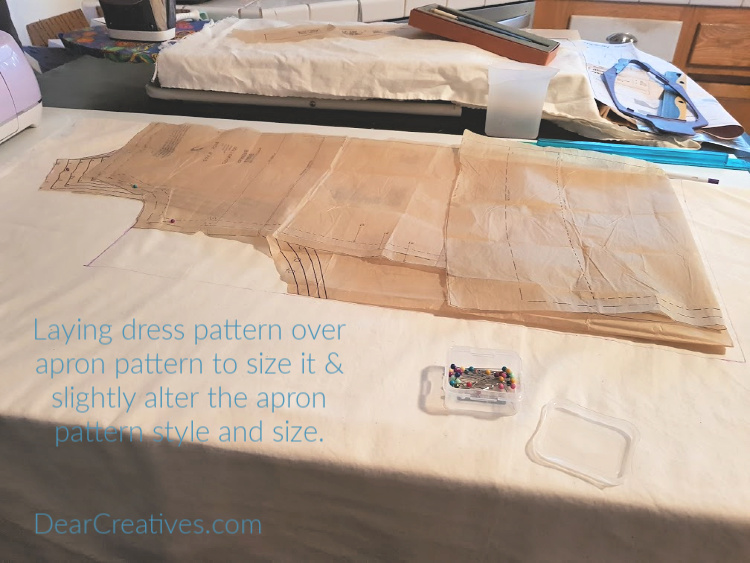 laying out the pattern for the apron - pinafore that goes with the dress -optionally, making size, and pattern adjustments DearCreatives.com