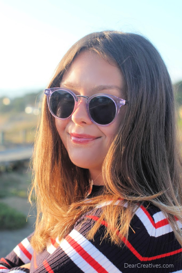 young lady wearing trendy sunglasses DearCreatives.com