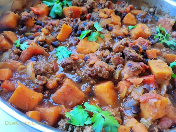 Chili with squash - butternut squash, black beans, ground beef. Cooked in 1 hour this makes an easy dinner for a crowd. This is perfect for a smaller family too as you can eat the left overs or even freeze the left overs to eat later. DearCreatives.com
