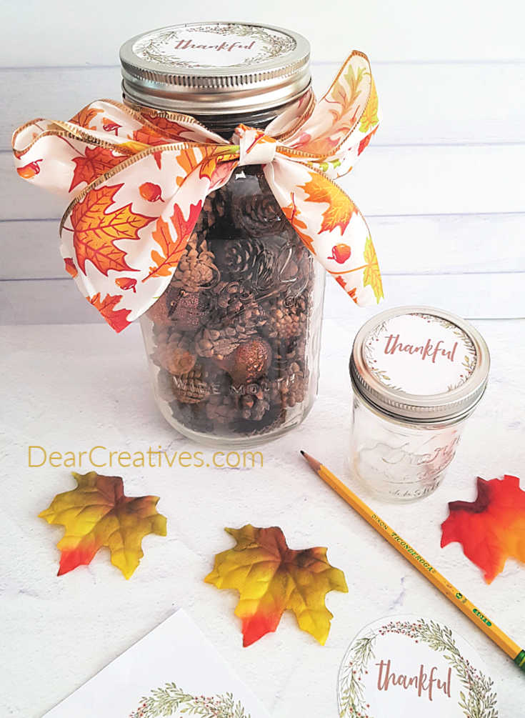 Getting ready to cut out the fall printable design, marking the circle with a pencil - DIY fall mason jar at DearCreatives.com