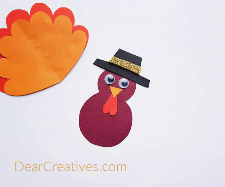 step (3) for a cardboard tube turkey craft - template and tutorial at DearCreatives.com