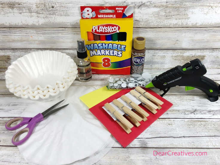 Materials for making a kids turkey craft. Find the instructions and finished fall craft for kids at DearCreatives.com