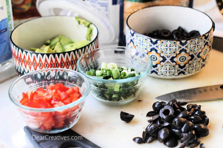 Prepping toppings for taco potatoes © DearCreatives.com
