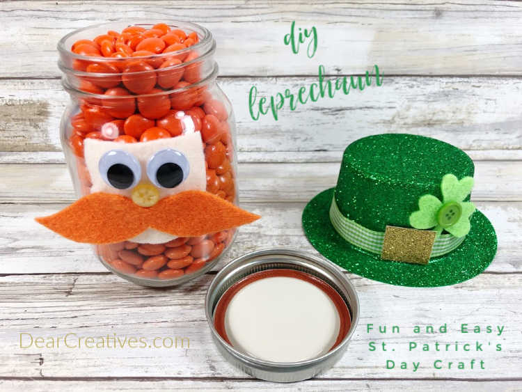 Decorated mason jar to look like a leprechaun and filled with candies. St. Patty's DIY at DearCreatives.com
