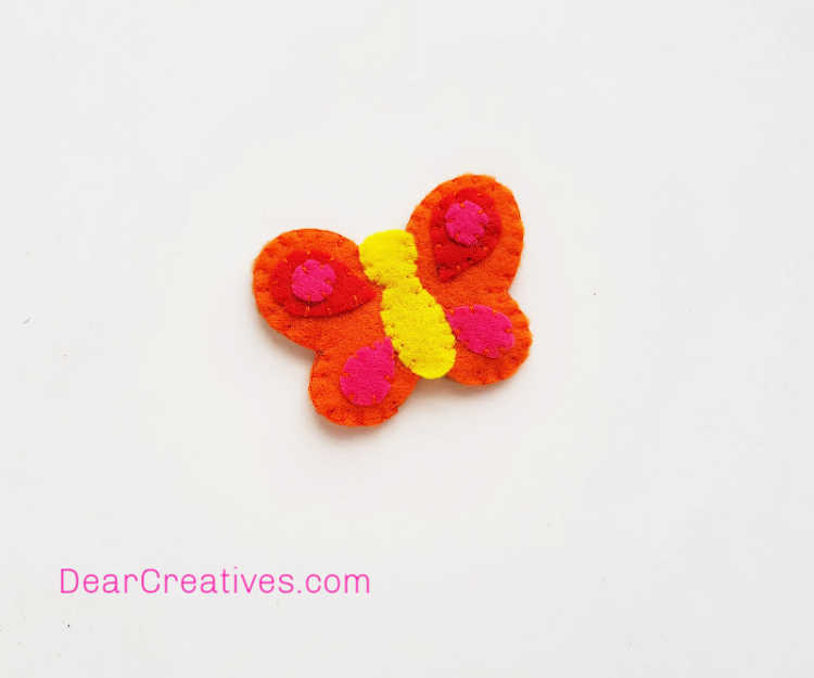 Butterfly Craft - Pencil Topper - Felt Craft - final steps (6) Finishing the butterfly pencil topper nu tying a knot with the thread... how to make a butterfly pencil topper at DearCreatives.com