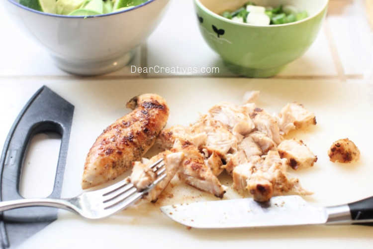 Chicken-being-chopped-for-chicken-taquitos-DearCreatives.com