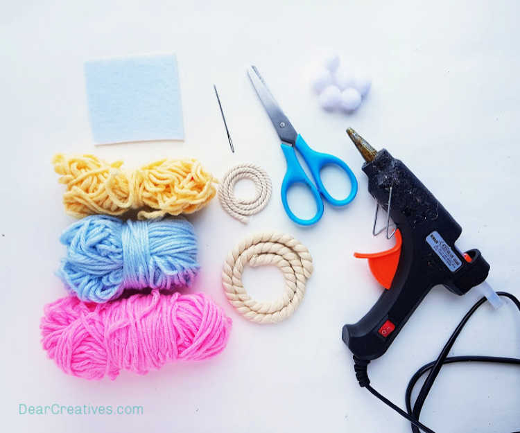 Craft supplies you will need for making a macrame rainbow wall hanging - DearCreatives.com