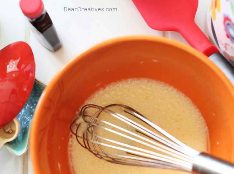 mixing egg, oil, vanilla extract...for making a recipe for blueberry bread - © DearCreatives.com
