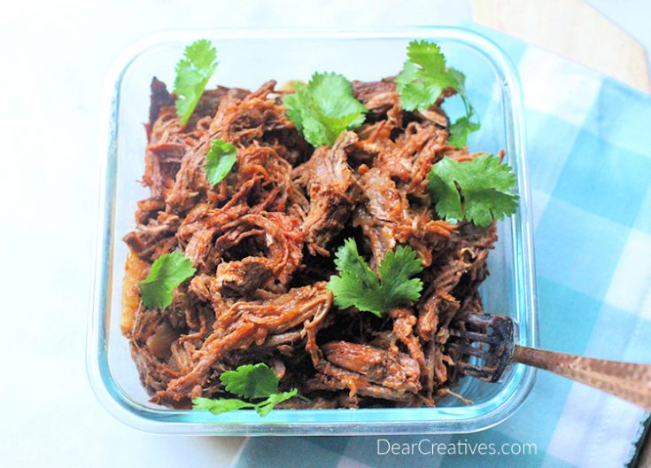 Beef barbacoa - Shredded beef cooked and ready to use in salads, tacos, burritos and other recipes. Get the beef barbacoa recipe - © DearCreatives.com