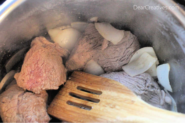 beef in an Instant Pot being braised for making beef barbacoa - DearCreatives.com