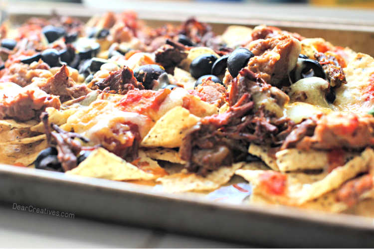 beef nachos - sheet-pan beef nachos made with shredded beef, beans, cheese, olives, salsa...© DearCreatives.com