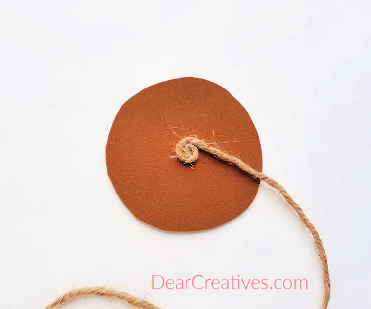 step (2) Begin by creating a swirl pattern. Full instructions for DIY rope coasters at DearCreatives.com