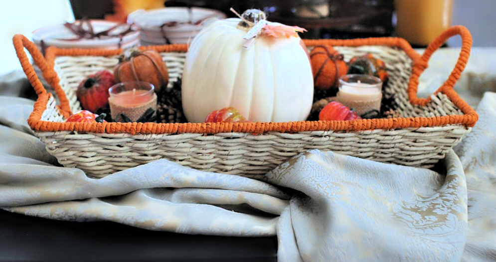 Basket on table with large pumpkin and fall decorations - Thanksgiving decor ideas- DearCreatives.com
