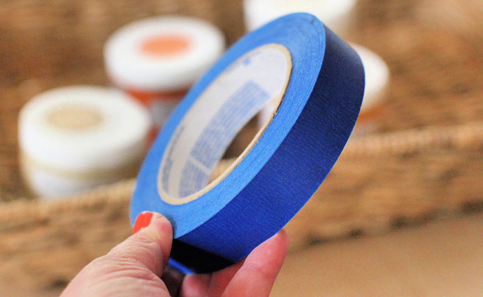 Close up of painters tape used for the fall craft project - decorating a basket with chalk paint. DearCreatives.com