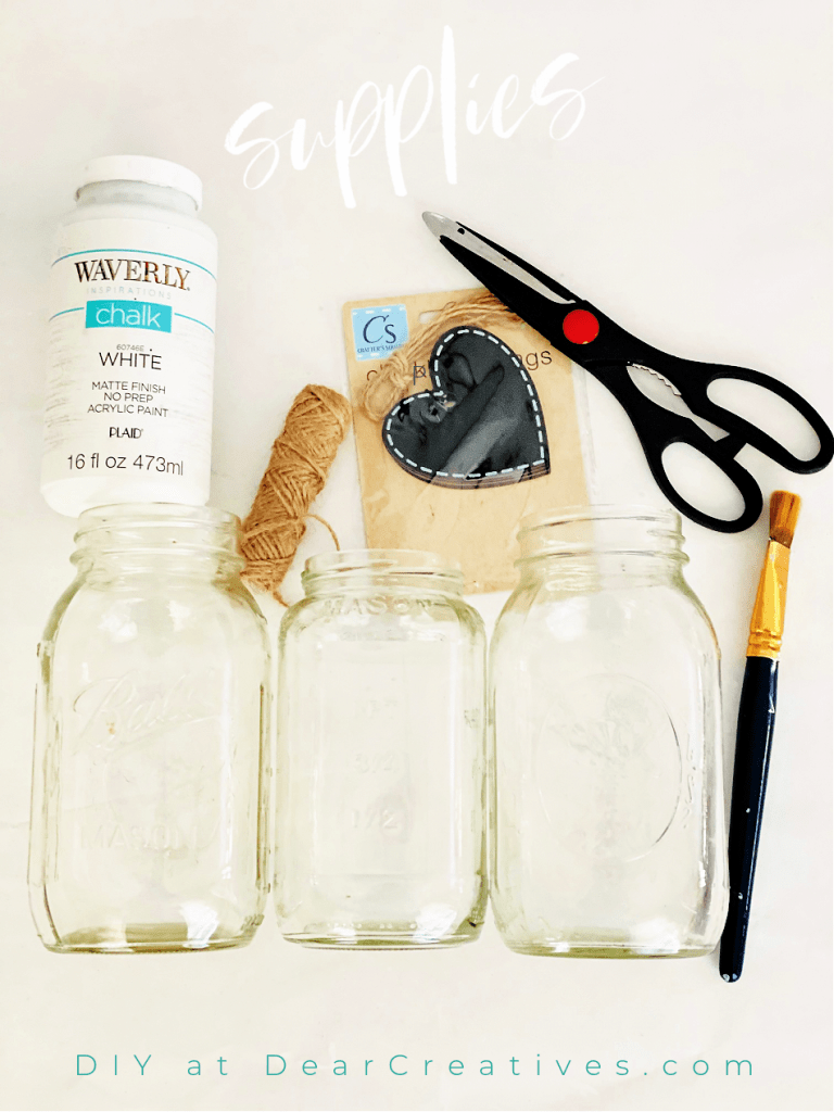 supplies for a mason jar craft -mason jars, chalk paint, twine, heart tags, paintbrush, scissors - See DIY at DearCreatives.com