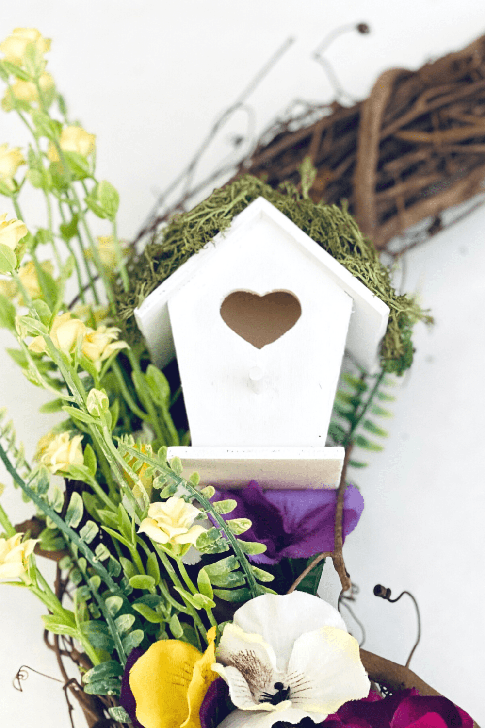 Step - Add the birdhouse to the decorated wreath - See how-to at DearCreatives.com