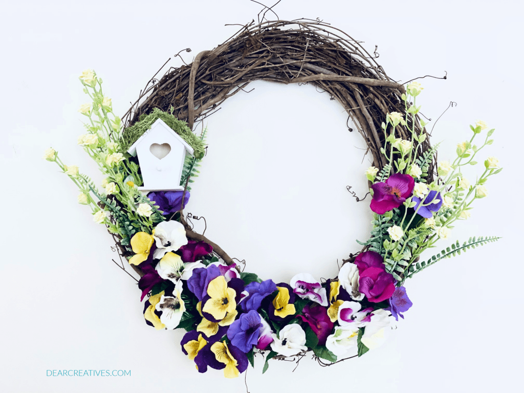Finished spring wreath ready to hang inside for spring decor or hang on the front door for spring. SPRING WREATH WITH FLOWERS...DearCreatives.com