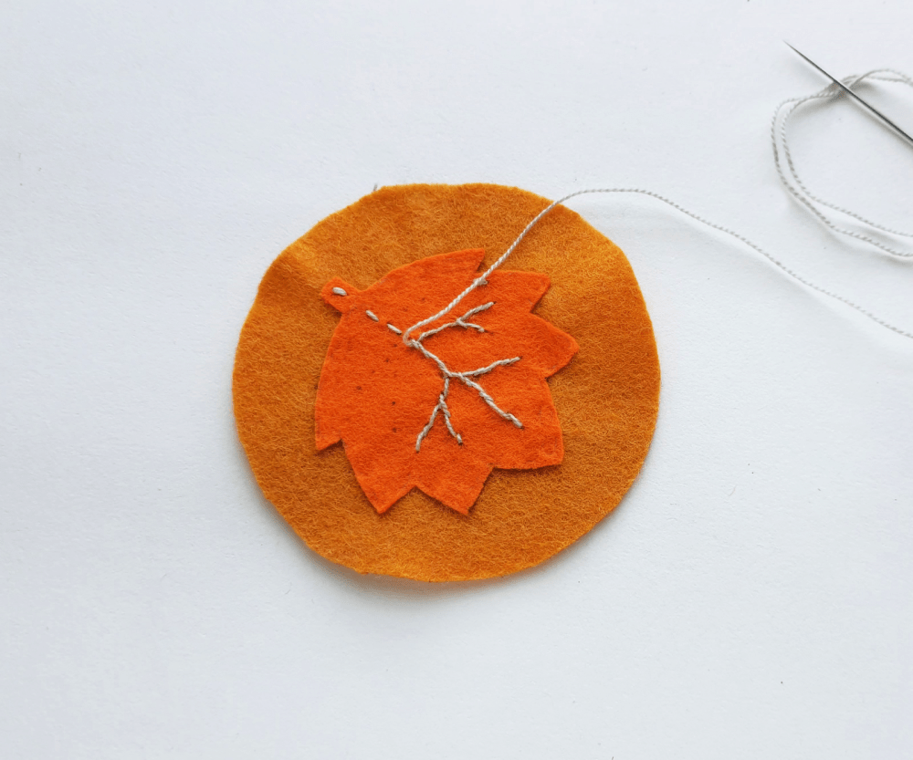 DIY Leaf Coasters - Steps (4). Use a fabric tracing pen (or chalk) to trace the veins... Instructions and felt leaf template at DearCreatives.com