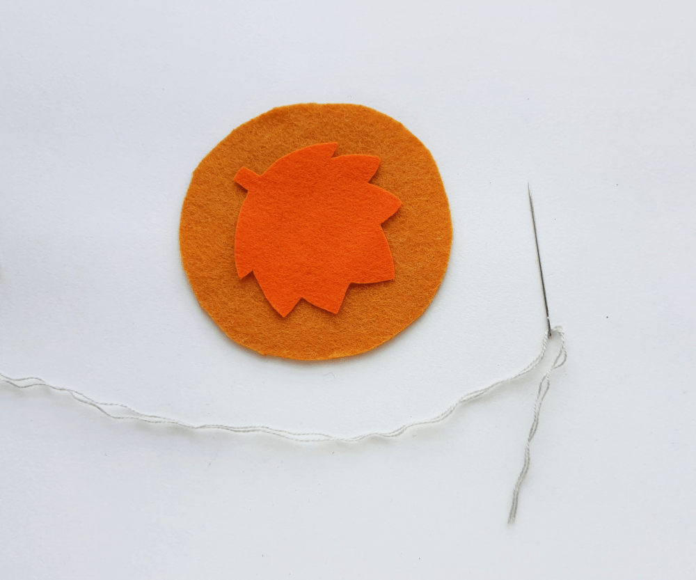 DIY Leaf Coaster - Step (1). Select 2 different colored felt fabrics for the maple leaf coaster... template and instructions at DearCreatives.com