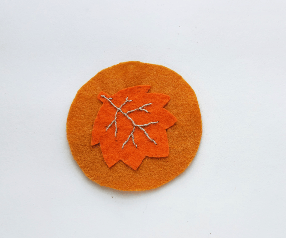 Maple Leaf Felt Coaster Steps (5).j Fill the vein lines with solid stitches... Felt Crafts and instructions for the coasters to make are at DearCreatives.com.